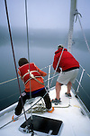Pulling up the anchor on a sailboat in The Basin. Phippsburg, Maine, USA