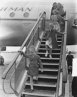 Princesses Irene and Beatrix have looked inside the plane in which Prince Bernhard is traveling. They are now walking down the flight of stairs. Keywords: airline Location: Schiphol; North Holland Date: May 29, 1949<br /> <br /> PHOTO :  Noske, J.D. / Anefo