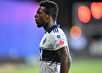 LAKE BUENA VISTA, FL - JULY 26: Cristian Dájome of Vancouver Whitecaps FC has a few choice words for the assistant referee during a game between Vancouver Whitecaps and Sporting Kansas City at ESPN Wide World of Sports on July 26, 2020 in Lake Buena Vista, Florida.
