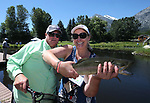 Breast cancer survivor Susan Powell poses with her catch and guide Jon Blakely during a Casting for Recovery retreat in Gardnerville, Nev., on Friday, June 30, 2017. <br /> Photo by Cathleen Allison/Nevada Photo Source