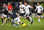Dundee v St Johnstone…12.02.16   SPFL   Dens Park, Dundee<br />Danny Swanson is tackled by Thomas Konrad<br />Picture by Graeme Hart.<br />Copyright Perthshire Picture Agency<br />Tel: 01738 623350  Mobile: 07990 594431