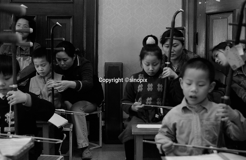 """Children undergo special extra schooling at a """"Children's Palace ion Shanghai, China. The Palaces offer extra tuition to doting parents who are only able to have a single Child under the strict One Child Policy law.  The single child each of whom has the attention of parents and 4 grandparents are often referred to as """"Little Emperors"""""""