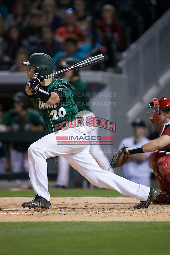 Nick Daddio (20) of the Charlotte 49ers follows through on his swing against the North Carolina State Wolfpack at BB&T Ballpark on March 31, 2015 in Charlotte, North Carolina.  The Wolfpack defeated the 49ers 10-6.  (Brian Westerholt/Four Seam Images)