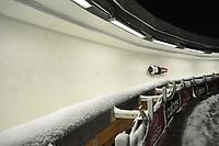 Men's skeleton race at night at the  2012 World Championships at  Lake Placid, New York