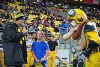 MC Greg Ellis with Captain Hurricane and a fan before the Super Rugby match between the Hurricanes and Southern Kings at Westpac Stadium, Wellington, New Zealand on Friday, 25 March 2016. Photo: Dave Lintott / lintottphoto.co.nz