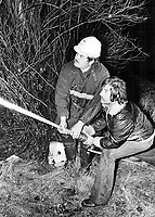 Des citoyens tentent d'éteindre les incendies durant la greve des pompiers coonnu comme '' le Week End Rouge '' en novembre 1974<br /> <br /> <br /> During illegal strike by Montreal firemen last month; the homes of 80 families were gutted despite attempts of civilians to fight the flames. The illegal strike has become almost commonplace; especially in the public sector.<br /> <br /> 1974<br /> <br /> PHOTO :  Bob Olsen - Toronto Star Archives - AQP