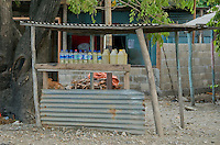 Vendors sell gasoline in re-used one liter water bottles on the street in Dili, Timor-Leste (East Timor)