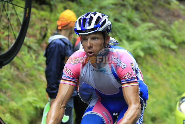 The peloton including Danilo Hondo (GER) Lampre-Farnese Vini approach the summit of the Cat 1 climb at Col du Marie Blanque during a wet foggy Stage 17 of the 2010 Tour de France running 174km from Pau to Col du Tourmalet, France. 22nd July 2010.<br /> (Photo by Eoin Clarke/NEWSFILE).<br /> All photos usage must carry mandatory copyright credit (© NEWSFILE | Eoin Clarke)
