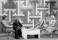 Montreal (Qc) CANADA - May 25 1984. RAJ (Rassemblement Autonome des Jeunes) representative (L) discuss with Pauline Marois (R) at at TV debate hosted by Mathias Rioux and ?