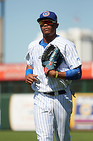 South Bend Cubs right fielder Eddy Martinez (15) jogs to the dugout during the second game of a doubleheader against the Peoria Chiefs on July 25, 2016 at Four Winds Field in South Bend, Indiana.  South Bend defeated Peoria 9-2.  (Mike Janes/Four Seam Images)