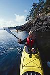 San Juan Islands, Sea kayaking couple off Orcas Island, Washington State, Pacific Northwest, USA,