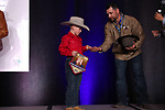 Cayden Burkholder during the bareback and saddle bronc back  number  presentation at the Junior World Finals Rodeo. Photo by Andy Watson. Written permission must be  provided  to use  this  photo  in any manner.