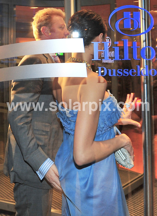 **ALL ROUND PICTURES FROM SOLARPIX.COM**.**SYNDICATION RIGHTS FOR UK AND SPAIN ONLY**.Boris Becker and girlfirend model Lilly Kerssenberg arriving at  the Hilton Hotel in Dusseldorf, Germany. 28 February 2009.This pic: Boris Becker and Lilly Kerssenberg..JOB REF: 8571 CPR (Pellens)  DATE: 28_02_2009.**MUST CREDIT SOLARPIX.COM OR DOUBLE FEE WILL BE CHARGED**.**ONLINE USAGE FEE  GBP 50.00 PER PICTURE - NOTIFICATION OF USAGE TO PHOTO @ SOLARPIX.COM**