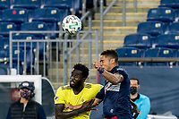 FOXBOROUGH, MA - OCTOBER 3: Derrick Jones #21 of Nashville SC and Brandon Bye #15 of New England Revolution battle for head ball during a game between Nashville SC and New England Revolution at Gillette Stadium on October 3, 2020 in Foxborough, Massachusetts.