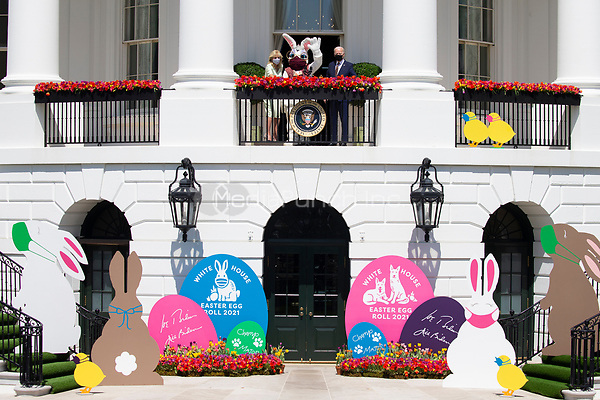 US President Joe Biden (R) and First Lady Jill Biden (L) stand with the Easter bunny (C) after President Biden delivered remarks regarding Easter, on the Truman Balcony at the South Lawn of the White House, in Washington, DC, USA, 05 April 2021. The traditional Easter Egg Roll at the White House with thousands of visitors was not held due to the coronavirus COVID-19 pandemic.<br /> Credit: Michael Reynolds / Pool via CNP /MediaPunch
