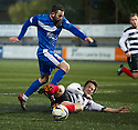 Montrose's Garry Wood is challenged by Shire's Christopher Townsley.