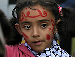 Palestinian child takes part in a protest against Israel's new military order in the West Bank town of Ramallah on 13 April 2010. The Israeli military commander of the West Bank, Gadi Shamni signed two new military orders, one designed to prevent infiltration, and another one regarding security directives. The orders permitting the immediate expulsion from the West Bank of thousands of Palestinians citizens holding IDs issued in Gaza, are supposed to take effect on 14 April. Israeli and Palestinian Human Rights organizations called the orders illegal, and said they permit arbitrary, extreme harm to a huge number of people. photo by Issam Rimawi