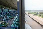 March 14, 2020: An empty grandstand overlooks racing on Rebel Stakes Day as the novel coronavirus pandemic sparks outbreaks across the country, causing the suspension of nearly all major sporting events with one of the few exceptions being horse racing. The need to keep thoroughbreds in good health has brought race tracks like Oaklawn Racing Casino Resort in Hot Springs, Arkansas to chose to allow racing, but kept the house empty of everyone but vital staff and some media in order to prevent the spread of COVID-19 on March 14, 2020. photo by Justin Manning/Eclipse Sportswire/CSM