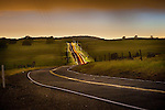 Rain-slick road at twilight, Calaveras County, Calif...*Composite of two photos, one for landscape, second for automobile.
