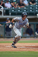 Jordan Gore (10) of the Pensacola Blue Wahoos starts down the first base line against the Birmingham Barons at Regions Field on July 7, 2019 in Birmingham, Alabama. The Barons defeated the Blue Wahoos 6-5 in 10 innings. (Brian Westerholt/Four Seam Images)