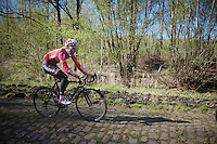 Kenny Dehaes (BEL/Lotto-Belisol) down the Arenberg cobbles<br /> <br /> 2014 Paris - Roubaix reconnaissance
