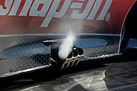 Feb. 9, 2012; Pomona, CA, USA; Detailed view of smoke coming from the exhaust pipes on the car of NHRA funny car driver Cruz Pedregon during qualifying at the Winternationals at Auto Club Raceway at Pomona. Mandatory Credit: Mark J. Rebilas-