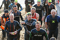 Pictured: Gareth Thomas (C) finishing his swim race at the North Beach in Tenby. Sunday 15 September 2019<br /> Re: Ironman triathlon event in Tenby, Wales, UK.