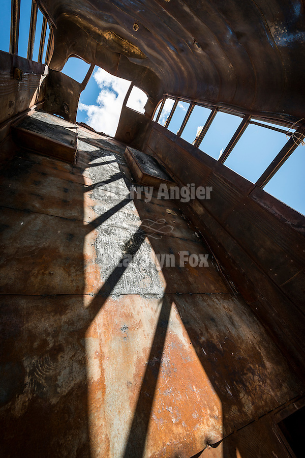 National Junk Car Forest! (World's Largest), Goldfield, Nev.<br /> <br /> Interior of a burned and rusting bus pointed into the sky