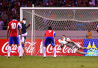 SAN JOSE, COSTA RICA - September 06, 2013: With this shot Clint Dempsey (8) of the USA MNT beat Keylor Navas (1) of the Costa Rica MNTto score from the penalty spot during a 2014 World Cup qualifying match at the National Stadium in San Jose on September 6. USA lost 3-1.