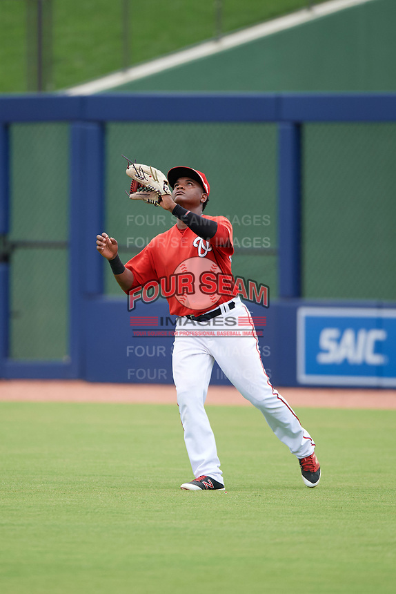 GCL Nationals right fielder Juan Evangelista (2) catches a fly ball during the second game of a doubleheader against the GCL Mets on July 22, 2017 at The Ballpark of the Palm Beaches in Palm Beach, Florida.  GCL Mets defeated the GCL Nationals 4-1.  (Mike Janes/Four Seam Images)