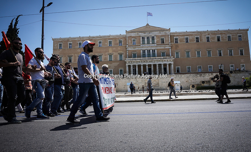 Pictured: Protesters walk past the Parliament building in Syntagma Square, Athens, Greece. Wednesday 30 May 2018<br /> Re: A 24-hour general strike called by Greece's labour unions to protest against the government's ongoing austerity, Athens, Greece.