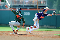 Second Baseman Steve Wilkerson #17 runs off after applying the tag on a hard sliding Garrett Kennedy during a  game against the Miami Hurricanes at Doug Kingsmore Stadium on March 31, 2012 in Clemson, South Carolina. The Tigers won the game 3-1. (Tony Farlow/Four Seam Images).