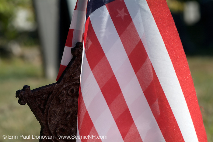 American Flag in a rusted star flag holder in a scenic New England cemetery during the summer months. USA