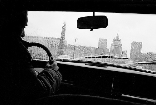 """Moscow, Russia<br /> October 19, 1992<br /> <br /> Moscow taxi drive - note very little traffic.<br /> <br /> In December 1991, food shortages in central Russia had prompted food rationing in the Moscow area for the first time since World War II. Amid steady collapse, Soviet President Gorbachev and his government continued to oppose rapid market reforms like Yavlinsky's """"500 Days"""" program. To break Gorbachev's opposition, Yeltsin decided to disband the USSR in accordance with the Treaty of the Union of 1922 and thereby remove Gorbachev and the Soviet government from power. The step was also enthusiastically supported by the governments of Ukraine and Belarus, which were parties of the Treaty of 1922 along with Russia.<br /> <br /> On December 21, 1991, representatives of all member republics except Georgia signed the Alma-Ata Protocol, in which they confirmed the dissolution of the Union. That same day, all former-Soviet republics agreed to join the CIS, with the exception of the three Baltic States."""