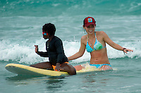 """Saturday, August 23 2008.  Volunteer Maddie Rupp gives """"Chare"""" (no last name given) a surf lesson during the 22nd Annual Kids Day hosted by the Windansea Surf Club at La Jolla Shores."""