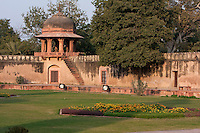 """Agra, India.  Interior Gardens of the  Itimad-ud-Dawlah, Mausoleum of Mirza Ghiyas Beg.  Chhatri on corner of garden wall.  The Itimad-ud-Dawlah is sometimes referred to as the """"Baby Taj."""""""