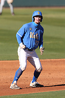Jack Filby (27) of the UCLA Bruins runs the bases during a game against the Cal State Fullerton Titans at Jackie Robinson Stadium on March 6, 2021 in Los Angeles, California. UCLA defeated Cal State Fullerton, 6-1. (Larry Goren/Four Seam Images)