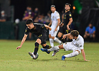 LAKE BUENA VISTA, FL - JULY 18: Eduard Atuesta #20 of LAFC tries to avoid the challenge by Emil Cuello #27 of LA Galaxy during a game between Los Angeles Galaxy and Los Angeles FC at ESPN Wide World of Sports on July 18, 2020 in Lake Buena Vista, Florida.