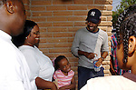 Actor/Comedian Chris Rock talks with Hurricane Katrina evacuees Jarmal and Myra McNeil and their daughter Jarlai Morris while on a visit to the Bonita House in Houston,Texas Thursday Sept. 29,2005.