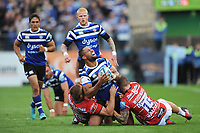 Joe Cokanasiga of Bath Rugby looks to be in pain as he is tackled by Jason Woodward of Gloucester Rugby during the Gallagher Premiership Rugby match between Bath Rugby and Gloucester Rugby at The Recreation Ground on Saturday 8th September 2018 (Photo by Rob Munro/Stewart Communications)