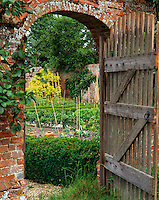 View through a door in the brick wall that surrounds the kitchen garden at Barton Court
