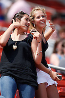 May 28, 2009:  Two female fans dance during a break in the action from a game at Coca-Cola Field in Buffalo, NY.  Photo by:  Mike Janes/Four Seam Images