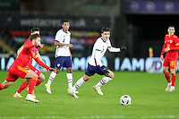 SWANSEA, WALES - NOVEMBER 12: Giovanni Reyna #7 of the United States  chases after a ball during a game between Wales and USMNT at Liberty Stadium on November 12, 2020 in Swansea, Wales.