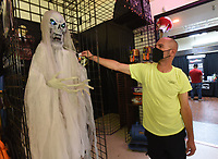 David Henderson, a manager at Halloween Express at Frisco Station Mall in Rogers, shows on Wednesday Oct. 6 2021 a ghost-like creature available at the store. Go to nwaonline.com/211010Daily/ to see more photos.<br />(NWA Democrat-Gazette/Flip Putthoff)