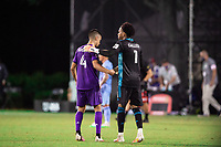 LAKE BUENA VISTA, FL - JULY 14: Joao Moutinho #4 and Pedro Gallese #1 of Orlando City SC celebrate a win during a game between Orlando City SC and New York City FC at Wide World of Sports on July 14, 2020 in Lake Buena Vista, Florida.