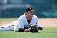 GCL Pirates pitcher Quinn Priester (34) watches the play after making a diving attempt on a batted ball during a Gulf Coast League game against the GCL Twins on August 6, 2019 at Pirate City in Bradenton, Florida.  GCL Twins defeated the GCL Pirates 4-2 in the first game of a doubleheader.  (Mike Janes/Four Seam Images)
