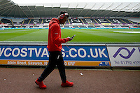 Daniel Sturridge of Liverpool looks at his phone as he arrives before the Barclays Premier League match between Swansea City and Liverpool played at the Liberty Stadium, Swansea on 1st May 2016