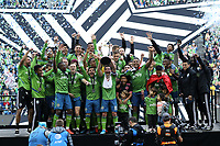 SEATTLE, WA - NOVEMBER 10: Nicolas Lodeiro #10 of the Seattle Sounders FC raises the Philip F. Anschutz trophy while celebrating with his teammates during a game between Toronto FC and Seattle Sounders FC at CenturyLink Field on November 10, 2019 in Seattle, Washington.