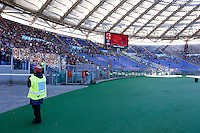 Calcio, Serie A: Roma vs Lazio. Roma, stadio Olimpico, 8 novembre 2015.<br /> A steward stands in front of the Roma fans' curva Sud sector almost empty, due to a protest against security measurements, prior to the start of the Italian Serie A football match between Roma and Lazio at Rome's Olympic stadium, 8 November 2015.<br /> UPDATE IMAGES PRESS/Riccardo De Luca