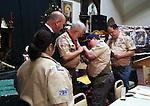 """WATERBURY, CT - Jan. 7 2014 - 010713AL01 - Michael LoVetro, right, pins the Boy Scouts of America Medal of Merit badge on John """"Jack"""" Shea, who used the Heimlich maneuver on a man who was choking at a Knights of Columbus picnic last summer. Shea was honored after a Knights of Columbus meeting at the McGivney Center in Waterbury Tuesday night. As a scout leader, Shea taught LoVetro the Heimlich maneuver. Andrew Larson / Republican-American"""
